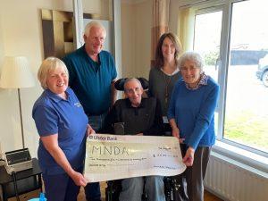 Annette family handing over cheque
