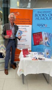 Brian Johnston holding books